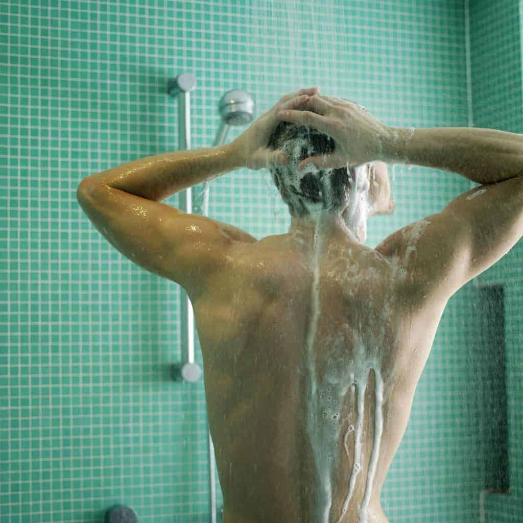 The man takes a shower